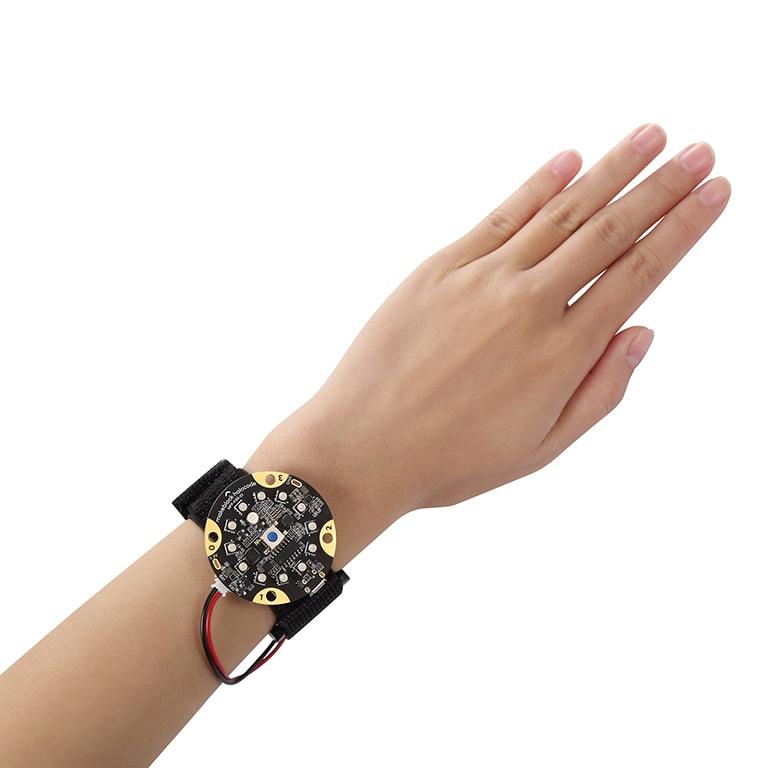 Halocode attached to an arm, like a bracelet